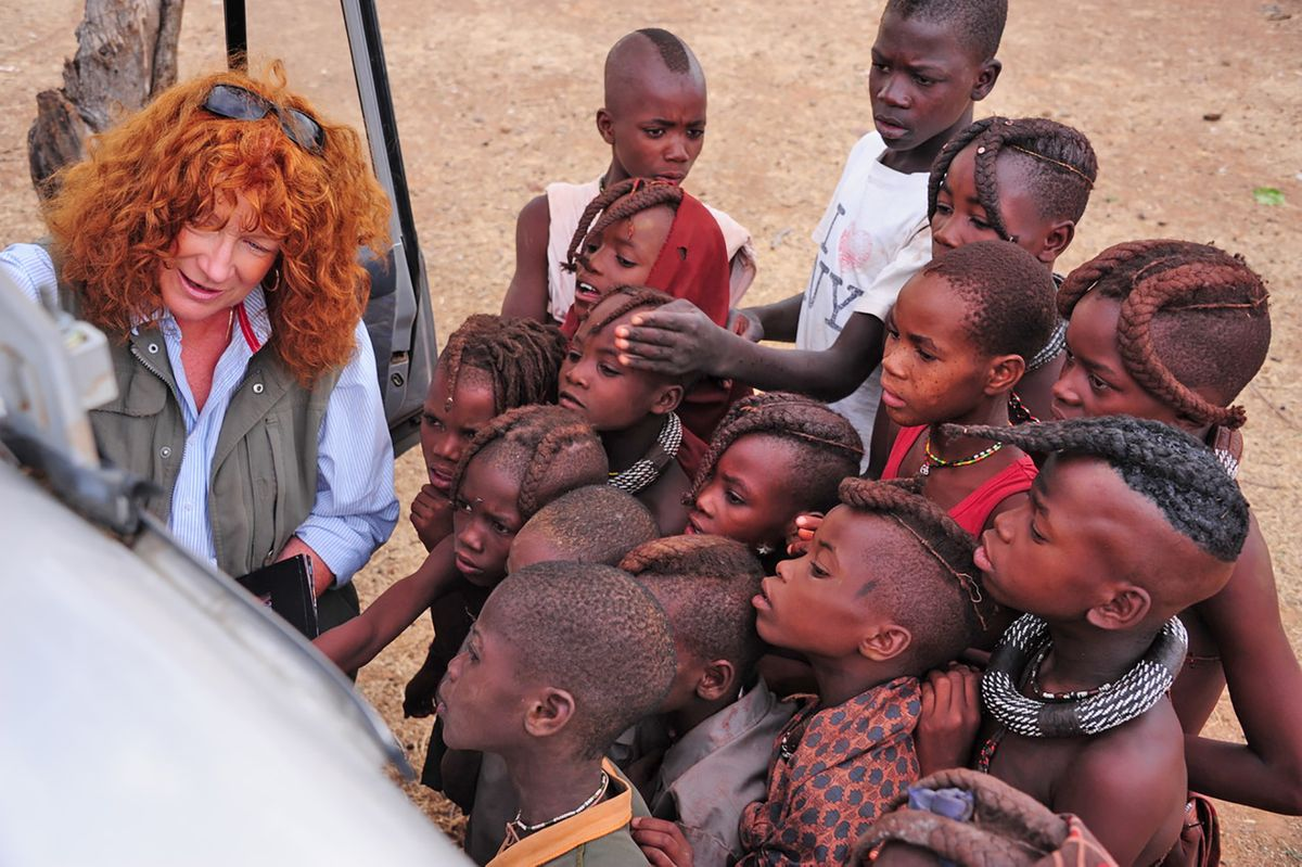 """WHO'S WHO ? FAIE DAVIS   shares printed images on the side of her truck to identify her little Himba  """" subjects """"  from the area of Opuwa in Namibia."""
