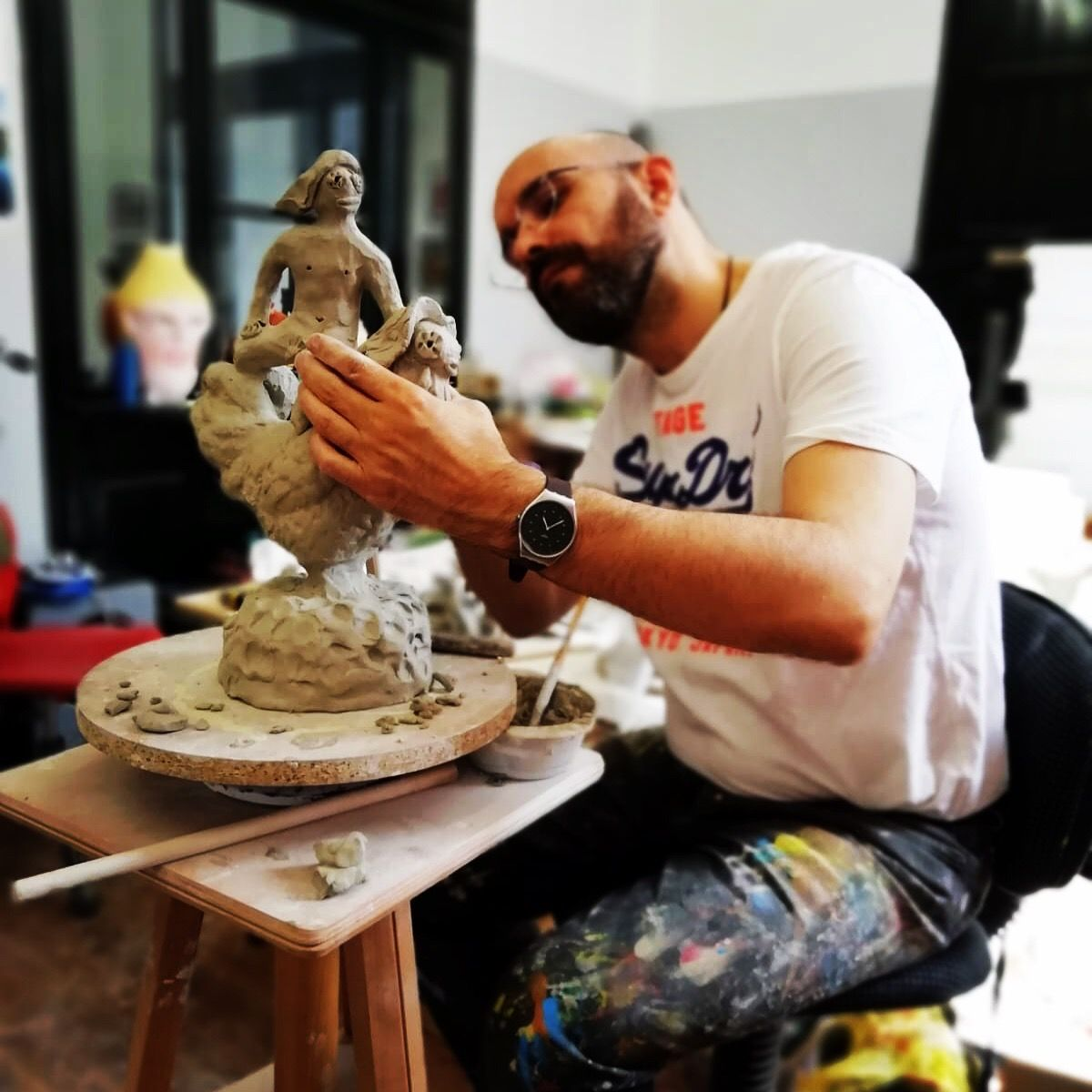 Artist working at his studio